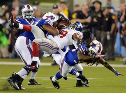 Big Hit by Aaron Williams! - Photo via RON SCHWANE/AP PHOTO