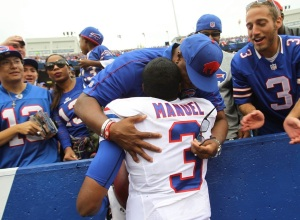 E.J. Manuel takes a moment to celebrate with his father following Sunday's win over the Carolina - Photo via www.wnypapers.com
