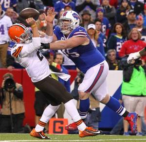 Kyle Williams forces a Manziel fumble that was later overturned - Photo via GARY WIEPERT AP PHOTO