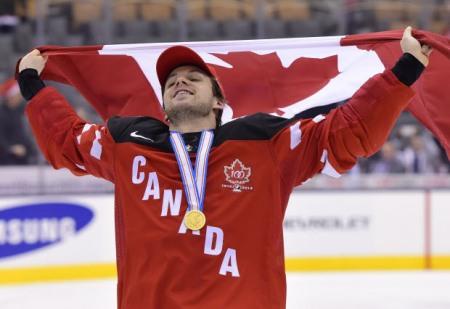 Reinhart celebrates gold.  Photo from o.canada.com