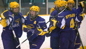 Skeats celebrates with teammates.  Photo from laurierathletics.com