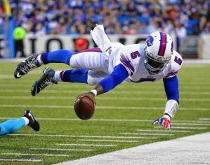 Tyrod dives for more yards.  Photo from syracuse.com