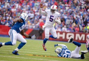 Buffalo Bills quarterback Tyrod Taylor (5) eludes Indianapolis Colts linebacker Trent Cole (58) and cornerback Darius Butler (20) during the first half of an NFL football game on Sunday, Sept. 13, 2015, in Orchard Park, N.Y. (AP Photo/Gary Wiepert)